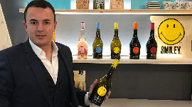 Mathias Icard smiles as he presents two reds (a Cabernet-Sauvignon and a Merlot), two whites (Chardonnay and Sauvignon Blanc) and a rosé at Vinexpo Paris.