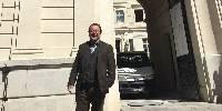Michel Chapoutier pose devant l'entrée du futur Carré du Palais, toujours en cours de travaux...